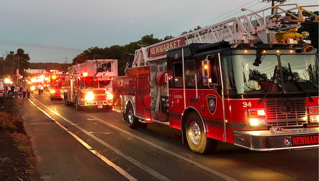 . Multiple fire trucks from surrounding communities arrive Thursday, Sept. 13, 2018, in Lawrence, Mass., responding to a series of gas explosions and fires triggered by a problem with a gas line that feeds homes in several communities north of Boston. (AP Photo/Phil Marcelo)