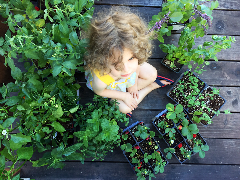 Gates Sits Amidst Her Plants