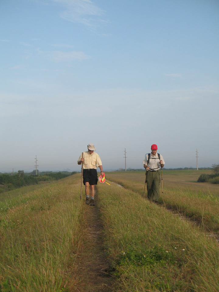Hikers on the dike at Moore Haven (Sandra Friend)