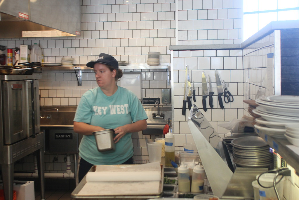 . Julie MacDonald works in the kitchen.