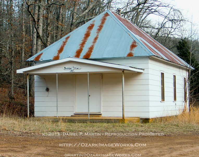 Dripping Springs Schoolhouse - Located about 4.25 miles north of Boston, AR via Madison Co 3175 to 3415, then SE on Madison Co 3500, just past the intersection of Madison Co 3415 / 3500.  Built in 1921, and still hanging on.<br /> <br /> The building has seen better days.  The isolated location, proximity to a popular swimming hole on the upper Kings River and the nearby Kings River Falls Natural Area are mixed blessings -- it's easy to drive to, but the schoolhouse and remaining outbuildings are occasional targets for vandalism.<br /> <br /> L1010534