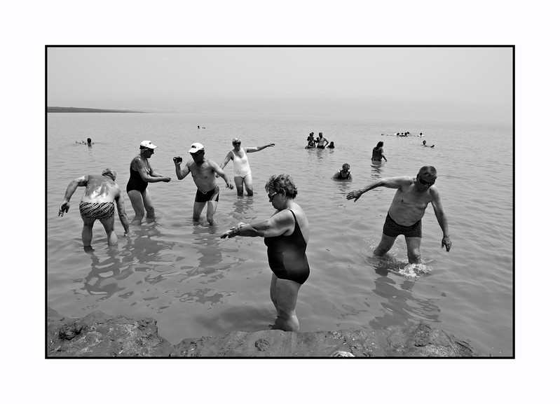 A Polish Tourist Group enjoy the mud of the Dead Sea.