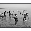 A Polish Tourist Group enjoy the mud of the Dead Sea.