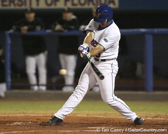 photo by Tim Casey<br /> <br /> Florida freshman Preston Tucker hits a single through the left side during the sixth inning of the Gators' 6-3 win on Friday, February 20, 2009 at McKethan Stadium in Gainesville, Fla.