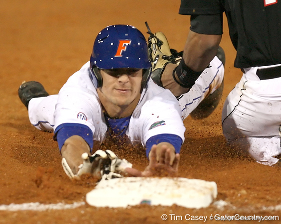photo by Tim Casey<br /> <br /> Florida sophomore outfielder Riley Cooper slides into third base on a play that was negated by a balk during the second inning of the Gators' 6-3 win on Friday, February 20, 2009 at McKethan Stadium in Gainesville, Fla.