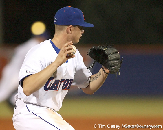 photo by Tim Casey<br /> <br /> Florida sophomore Josh Adams throws out a runner at first base during the seventh inning of the Gators' 6-3 win on Friday, February 20, 2009 at McKethan Stadium in Gainesville, Fla.