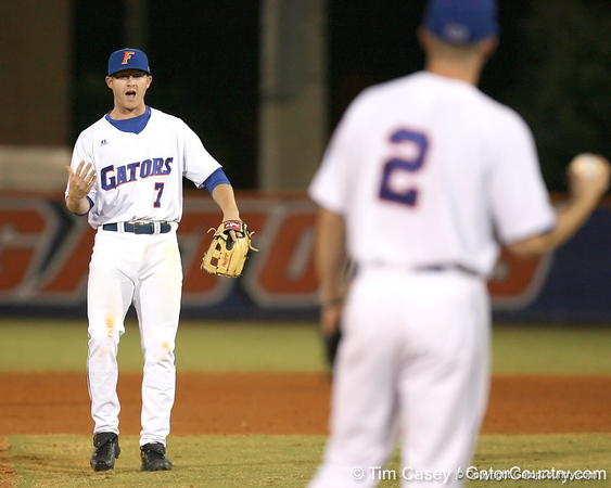 photo by Tim Casey<br /> <br /> Florida junior Clayton Pisani talks with Josh Adams during the fourth inning of the Gators' 6-3 win on Friday, February 20, 2009 at McKethan Stadium in Gainesville, Fla.