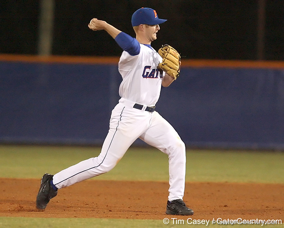 photo by Tim Casey<br /> <br /> Florida junior Clayton Pisani throws out a runner at first base during the fifth inning of the Gators' 6-3 win on Friday, February 20, 2009 at McKethan Stadium in Gainesville, Fla.