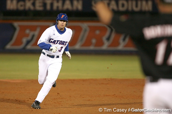 photo by Tim Casey<br /> <br /> Florida senior first baseman Brandon McArthur runs out a triple during the first inning of the Gators' 6-3 win on Friday, February 20, 2009 at McKethan Stadium in Gainesville, Fla.