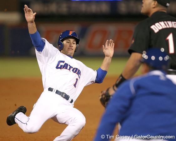 photo by Tim Casey<br /> <br /> Florida senior Avery Barnes slides into third base during the first inning of the Gators' 6-3 win on Friday, February 20, 2009 at McKethan Stadium in Gainesville, Fla.