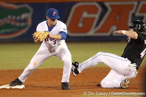 photo by Tim Casey<br /> <br /> Florida junior Clayton Pisani catches a throw from Josh Adams for a fielder's choice to end the second inning during the Gators' 6-3 win on Friday, February 20, 2009 at McKethan Stadium in Gainesville, Fla.