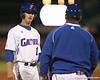 photo by Tim Casey<br /> <br /> Florida senior Avery Barnes talks with baseball assistant coach Craig Bell during the first inning of the Gators' 6-3 win on Friday, February 20, 2009 at McKethan Stadium in Gainesville, Fla.
