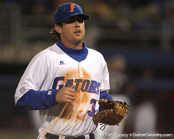 photo by Tim Casey<br /> <br /> Florida senior first baseman Brandon McArthur walks off of the field during the fourth inning of the Gators' 6-3 win on Friday, February 20, 2009 at McKethan Stadium in Gainesville, Fla.