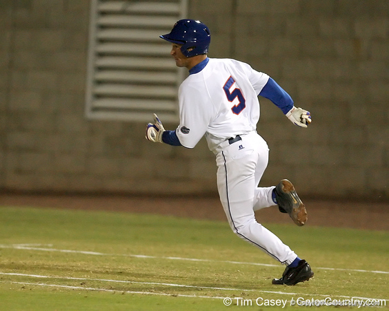 photo by Tim Casey<br /> <br /> Florida junior shortstop Mike Mooney gets on RBI on a fielding error by the shortstop during the second inning of the Gators' 6-3 win on Friday, February 20, 2009 at McKethan Stadium in Gainesville, Fla.