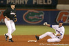 photo by Tim Casey<br /> <br /> Florida sophomore outfielder Riley Cooper slides into second base during the second inning of the Gators' 6-3 win on Friday, February 20, 2009 at McKethan Stadium in Gainesville, Fla.