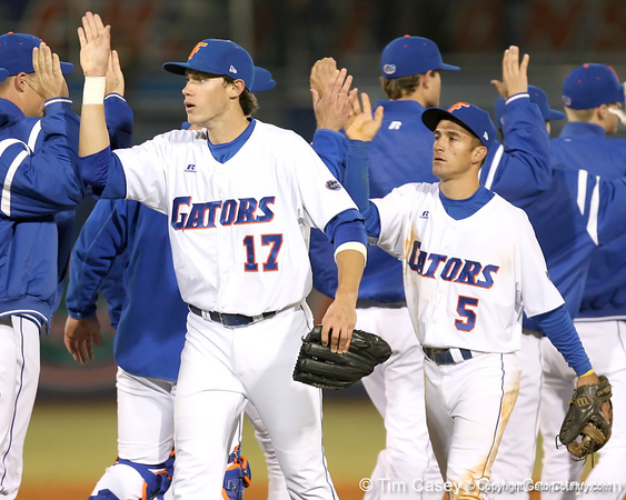 photo by Tim Casey<br /> <br /> Florida junior Matt den Dekker and Mike Mooney celebrate with teammates after the Gators' 6-3 win on Friday, February 20, 2009 at McKethan Stadium in Gainesville, Fla.