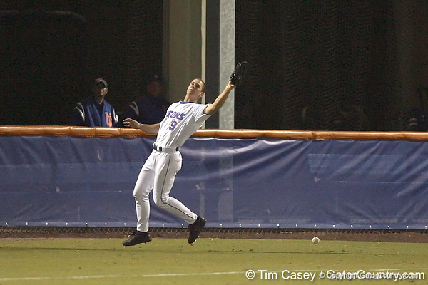 photo by Tim Casey<br /> <br /> Florida junior outfielder Jonathan Pigott misplays a fly ball during the ninth inning of the Gators' 6-3 win on Friday, February 20, 2009 at McKethan Stadium in Gainesville, Fla.