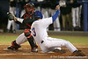 photo by Tim Casey<br /> <br /> Florida senior first baseman Brandon McArthur scores on an RBI sacrifice fly by Preston Tucker during the first inning of the Gators' 6-3 win on Friday, February 20, 2009 at McKethan Stadium in Gainesville, Fla.