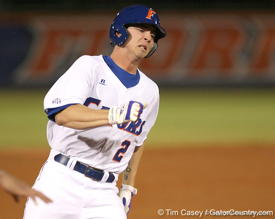 photo by Tim Casey<br /> <br /> Florida sophomore Josh Adams scores on a triple by Brandon McArthur during the first inning of the Gators' 6-3 win on Friday, February 20, 2009 at McKethan Stadium in Gainesville, Fla.