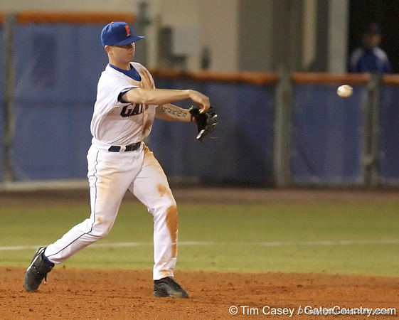 photo by Tim Casey<br /> <br /> Florida sophomore Josh Adams throws the ball around he horn after catching a line drive during the eighth inning of the Gators' 6-3 win on Friday, February 20, 2009 at McKethan Stadium in Gainesville, Fla.