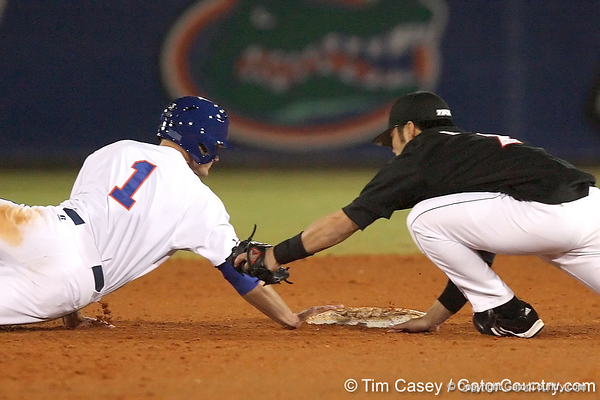 photo by Tim Casey<br /> <br /> Florida senior Avery Barnes returns to second base after an RBI single by junior Matt den Dekker during the seventh inning of the Gators' 6-3 win on Friday, February 20, 2009 at McKethan Stadium in Gainesville, Fla.