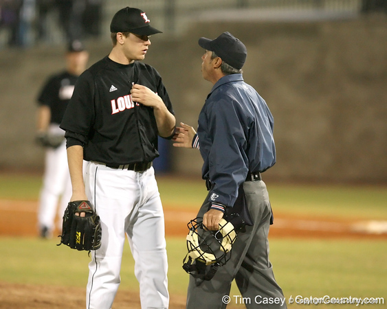 photo by Tim Casey<br /> <br /> Home plate umpire A.J. Lostaglio calls a balk on Louisville pitcher Justin Marks during the second inning of the Gators' 6-3 win on Friday, February 20, 2009 at McKethan Stadium in Gainesville, Fla.