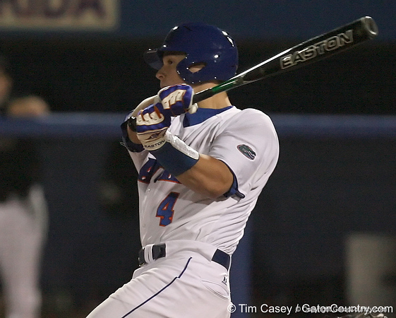 photo by Tim Casey<br /> <br /> Florida junior catcher Buddy Munroe hits a single to left field during the  seventh inning of the Gators' 6-3 win on Friday, February 20, 2009 at McKethan Stadium in Gainesville, Fla.