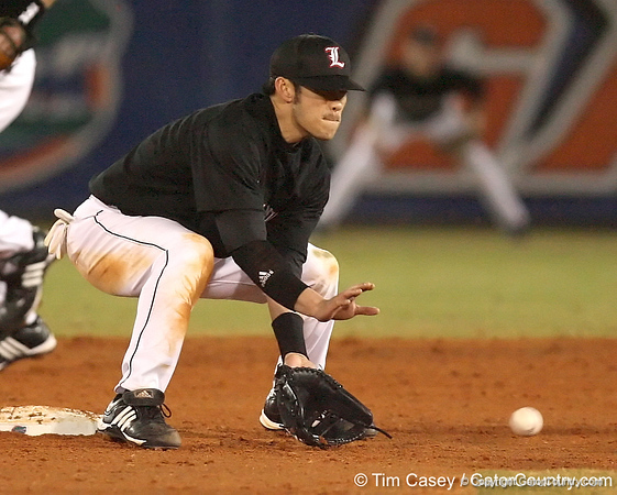 photo by Tim Casey<br /> <br /> Louisville shortstop John Dao fields a throw from the catcher as Florida junior shortstop Mike Mooney attempts to steal second base during the fifth inning of the Gators' 6-3 win on Friday, February 20, 2009 at McKethan Stadium in Gainesville, Fla.