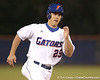 photo by Tim Casey<br /> <br /> Florida freshman Preston Tucker runs under a pop fly during the sixth inning of the Gators' 6-3 win on Friday, February 20, 2009 at McKethan Stadium in Gainesville, Fla.