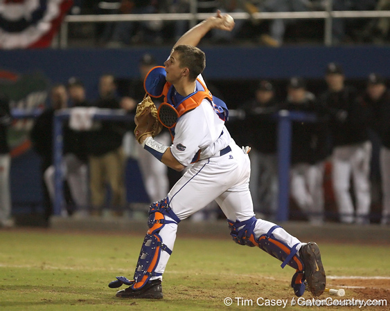 photo by Tim Casey<br /> <br /> Florida junior catcher Buddy Munroe throws to second base during the  fourth inning of the Gators' 6-3 win on Friday, February 20, 2009 at McKethan Stadium in Gainesville, Fla.