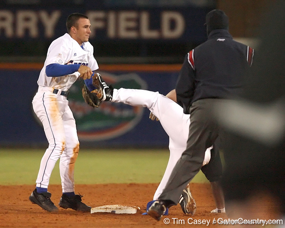 photo by Tim Casey<br /> <br /> Florida junior shortstop Mike Mooney tags out Andrew Clark at second base on a throw from right fielder Riley Cooper during the sixth inning of the Gators' 6-3 win on Friday, February 20, 2009 at McKethan Stadium in Gainesville, Fla.