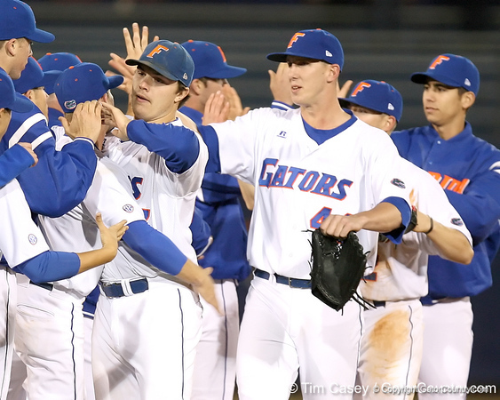 photo by Tim Casey<br /> <br /> Florida senior pitcher Patrick Keating and Billy Bullock celebrate with teammates after the Gators' 6-3 win on Friday, February 20, 2009 at McKethan Stadium in Gainesville, Fla.