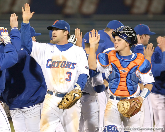 photo by Tim Casey<br /> <br /> Florida senior first baseman Brandon McArthur and Buddy Munroe celebrate with teammates after the Gators' 6-3 win on Friday, February 20, 2009 at McKethan Stadium in Gainesville, Fla.