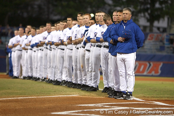 photo by Tim Casey<br /> <br /> Florida baseball head coach Kevin O'Sullivan listens to national anthem before the Gators' 6-3 win on Friday, February 20, 2009 at McKethan Stadium in Gainesville, Fla.