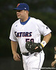 photo by Tim Casey<br /> <br /> Florida senior catcher Teddy Foster walks off of the field before the Gators' 6-3 win on Friday, February 20, 2009 at McKethan Stadium in Gainesville, Fla.