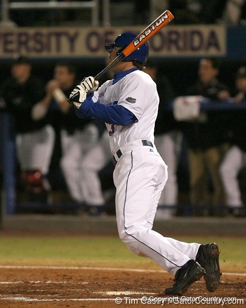 photo by Tim Casey<br /> <br /> Florida senior first baseman Brandon McArthur hits a triple during the first inning of the Gators' 6-3 win on Friday, February 20, 2009 at McKethan Stadium in Gainesville, Fla.