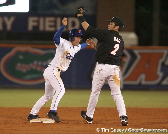 photo by Tim Casey<br /> <br /> Louisville shortstop John Dao fields tags out Florida junior shortstop Mike Mooney on a stolen base attempt during the fifth inning of the Gators' 6-3 win on Friday, February 20, 2009 at McKethan Stadium in Gainesville, Fla.
