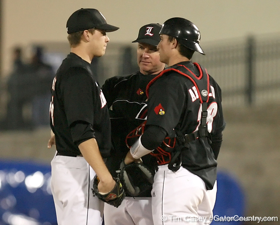 photo by Tim Casey<br /> <br /> Louisville pitcher Justin Mark listens to his coach during the Gators' 6-3 win on Friday, February 20, 2009 at McKethan Stadium in Gainesville, Fla.