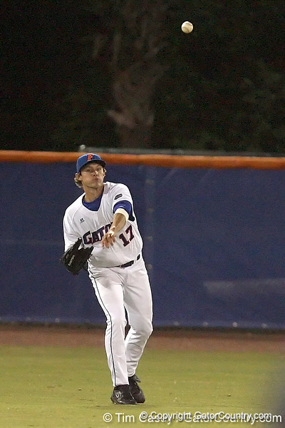 photo by Tim Casey<br /> <br /> Florida junior Matt den Dekker throws back to the infield during the Gators' 6-3 win on Friday, February 20, 2009 at McKethan Stadium in Gainesville, Fla.