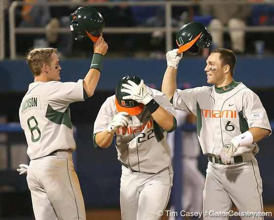 photo by Tim Casey<br /> <br /> Jonathan Weislow celebrates with teammates after hitting a three-run home run during the sixth inning of the Gators' 8-5 loss to the Miami Hurricanes on Friday, February 27, 2009 at McKethan Stadium in Gainesville, Fla.