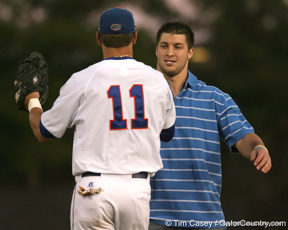 photo by Tim Casey<br /> <br /> Florida senior quarterback Tim Tebow hugs Riley Cooper after throwing out the first pitch during the Gators' 8-5 loss to the Miami Hurricanes on Friday, February 27, 2009 at McKethan Stadium in Gainesville, Fla.