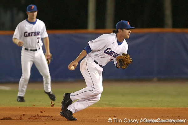 photo by Tim Casey<br /> <br /> Florida senior first baseman Brandon McArthur tosses the ball to first base during the second inning of the Gators' 8-5 loss to the Miami Hurricanes on Friday, February 27, 2009 at McKethan Stadium in Gainesville, Fla.