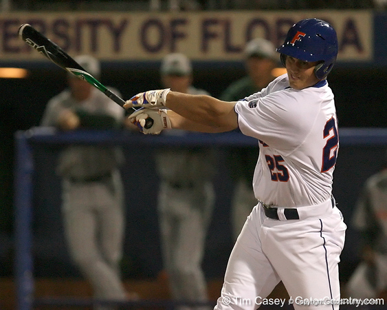 photo by Tim Casey<br /> <br /> Florida freshman Preston Tucker hits an infield single during the second inning of the Gators' 8-5 loss to the Miami Hurricanes on Friday, February 27, 2009 at McKethan Stadium in Gainesville, Fla.