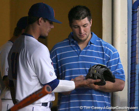 photo by Tim Casey<br /> <br /> Florida sophomore outfielder Riley Cooper talks with senior quarterback Tim Tebow before the Gators' 8-5 loss to the Miami Hurricanes on Friday, February 27, 2009 at McKethan Stadium in Gainesville, Fla.