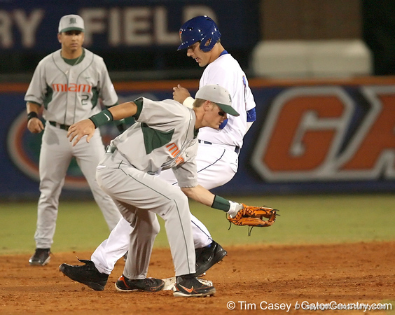 photo by Tim Casey<br /> <br /> Florida sophomore outfielder Riley Cooper is safe at second after a fielder's choice to the pitcher during the third inning of the Gators' 8-5 loss to the Miami Hurricanes on Friday, February 27, 2009 at McKethan Stadium in Gainesville, Fla.