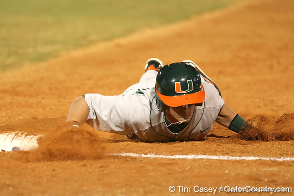 photo by Tim Casey<br /> <br /> Ryan Jackson dives back to first base during the sixth inning of the Gators' 8-5 loss to the Miami Hurricanes on Friday, February 27, 2009 at McKethan Stadium in Gainesville, Fla.