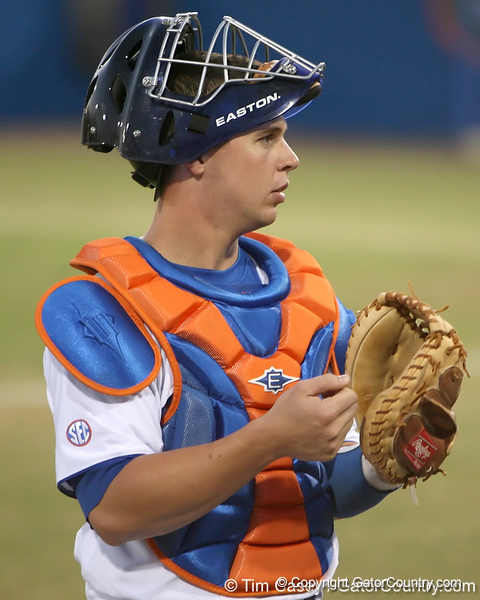 photo by Tim Casey<br /> <br /> Florida junior catcher Buddy Munroe warms up before the Gators' 8-5 loss to the Miami Hurricanes on Friday, February 27, 2009 at McKethan Stadium in Gainesville, Fla.