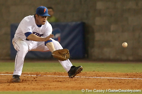 photo by Tim Casey<br /> <br /> Florida senior first baseman Brandon McArthur fields a ground ball during the third inning of the Gators' 8-5 loss to the Miami Hurricanes on Friday, February 27, 2009 at McKethan Stadium in Gainesville, Fla.