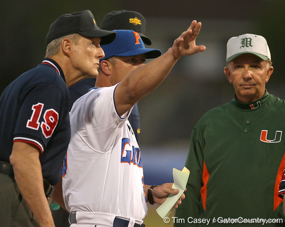 photo by Tim Casey<br /> <br /> Florida baseball head coach Kevin O'Sullivan goes over ground rules before the Gators' 8-5 loss to the Miami Hurricanes on Friday, February 27, 2009 at McKethan Stadium in Gainesville, Fla.