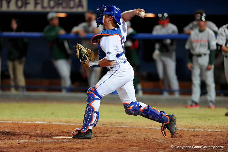 Junior catcher Hampton Tignor throws the ball to the pitcher during the Gators' 8-5 loss to the Miami Hurricanes at McKethan Stadium / Gator Country photo by Casey Brooke Lawson